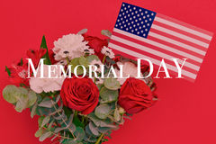 Beautiful bouquet with american flag on red background Stock Images