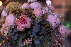 Beautiful bouquet of artificial flowers. Colorful artificial decorations and decor stock photography