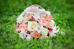 Beautiful bouquet of the bride. Executed from light pink and beige roses Stock Image