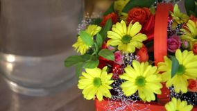 Beautiful bouquet of bright flowers in basket.  stock footage