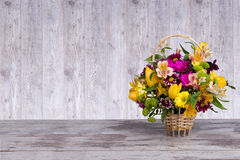 Beautiful bouquet of bright flowers in basket. Bouquet of bright flowers in basket royalty free stock image