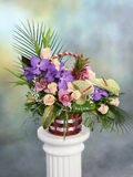 Beautiful bouquet of bright flowers in basket. Bouquet with colorful flowers in basket with blurred background Stock Photography