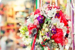 Beautiful bouquet of bright flowers in basket Royalty Free Stock Photo