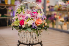 Beautiful bouquet of bright flowers in basket Royalty Free Stock Photos