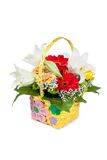 Beautiful bouquet of bright flowers in basket Stock Images