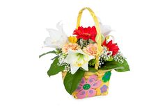 Beautiful bouquet of bright flowers in basket Stock Image
