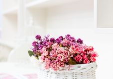 Beautiful bouquet of bright flowers in basket Royalty Free Stock Photography