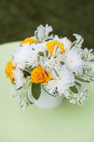 Beautiful bouquet of bright flowers in white vase,  on bright background Royalty Free Stock Photos