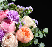 Beautiful bouquet of bright white pink purple roses flowers with. Green leafs on black background stock photos