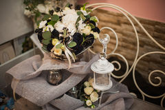Beautiful bouquet of bright white rose and black decor Royalty Free Stock Image