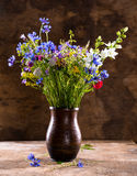 Beautiful bouquet of bright wildflowers in vase Stock Photos