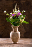 Beautiful bouquet of bright wildflowers in vase Stock Images