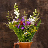 Beautiful bouquet of bright wildflowers in vase stock image