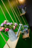 Beautiful bouquet of bright wildflowers in watering can Royalty Free Stock Image