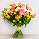 Beautiful bouquet of bush roses. On a wooden background Stock Image
