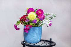 Beautiful bouquet of chrysanthemums flowers in blue vase stock photo