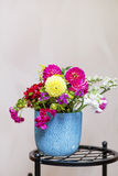 Beautiful bouquet of chrysanthemums  flowers in blue vase Royalty Free Stock Images