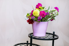 Beautiful bouquet of chrysanthemums  flowers in pink vase Royalty Free Stock Photos