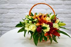 Beautiful flower basket on a table royalty free stock image