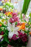 A beautiful bouquet of different flowers with a large white lily in a flower shop.  royalty free stock images