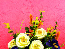 Beautiful bouquet of fake flower on pink background Stock Image