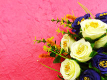Beautiful bouquet of fake flower on pink background Stock Photography