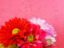 Beautiful bouquet of fake flowers on pink background Royalty Free Stock Images