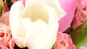 Beautiful bouquet flower with roses and tulips, on white, rotation, close up stock video