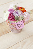 Beautiful bouquet in flowerpot and a card with the text Royalty Free Stock Image