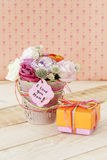 Beautiful bouquet in flowerpot and a gift box for Mother's Day Stock Photography
