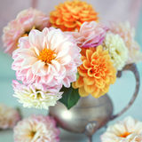 Beautiful bouquet of flowers. Beautiful bouquet of a yellow and pink dahlias on a light green background.Lovely bunch of flowers royalty free stock photos
