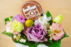 Beautiful bouquet of flowers and a biscuit Royalty Free Stock Images