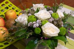 Beautiful bouquet of flowers and fruits royalty free stock image
