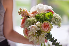 Beautiful bouquet flowers in the hand of girl Royalty Free Stock Image