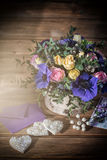 Beautiful bouquet flowers and hearts Stock Images