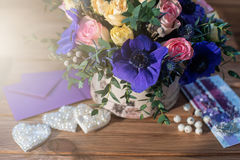 Beautiful bouquet flowers and hearts Stock Photos