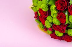 Beautiful bouquet of flowers on pink background royalty free stock image