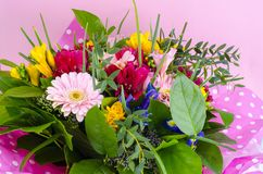 Beautiful bouquet of flowers on pink background royalty free stock photos