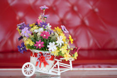 Beautiful bouquet of flowers in white basket Stock Photos