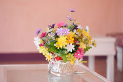 Beautiful bouquet of flowers in white basket Stock Image
