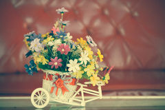 Beautiful bouquet of flowers in white basket on table Royalty Free Stock Images