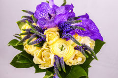 Beautiful bouquet flowers of white Ranunculus, iris purple iris Royalty Free Stock Photos
