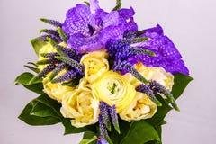 Beautiful bouquet flowers of white Ranunculus, iris purple iris Royalty Free Stock Photos