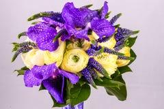 Beautiful bouquet flowers of white Ranunculus, iris purple iris, lupine Royalty Free Stock Photos