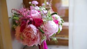 Beautiful bouquet of flowers on window sill. Beautiful bouquet of pink and white flowers are on the windowsill. HD stock video