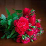 Beautiful bouquet of flowers on wooden table old. Royalty Free Stock Photo