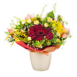 Beautiful bouquet of gerbera, carnations and other flowers in va Stock Photos