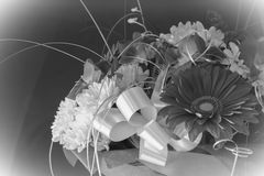 Beautiful bouquet of gerbera flowers and chrysanthemum on a diff Stock Photos