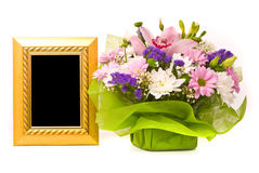 Beautiful bouquet and golden frame Stock Photos