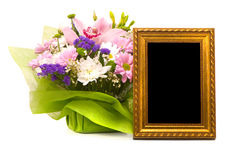 Beautiful bouquet and golden frame Royalty Free Stock Photos